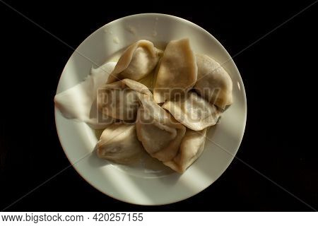 Vareniks Of Boiled Meat Are Served With Sour Cream. Traditional Russian Dumplings. View From Above.