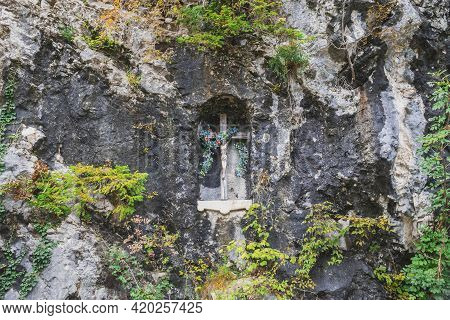 Wooden Cross With A Crucifix In The Rock