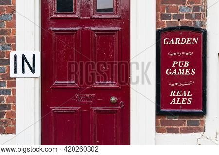 Buckinghamshire, Uk - December 25, 2020. Detail Of A Red Front Door To A Typical Uk High Street Brit