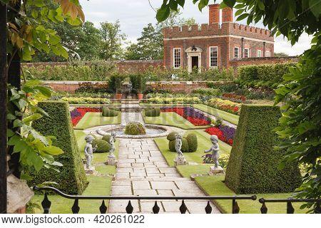 London, Uk - July 22, 2011. Hampton Court Palace Gardens. Pond Gardens And Banqueting House At Hampt