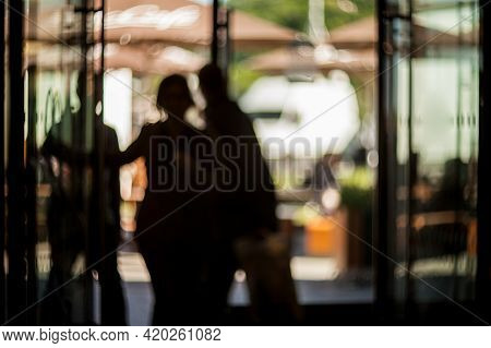 Blurred Silhouettes Of People In The Business Center. Lobby In The Rush Hour Is Made In The Manner O