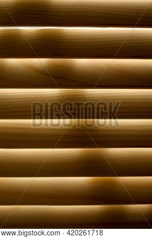 Window Shutters. Arched Windows With A Lattice.light Through The Arched Windows. Wooden Shutters On
