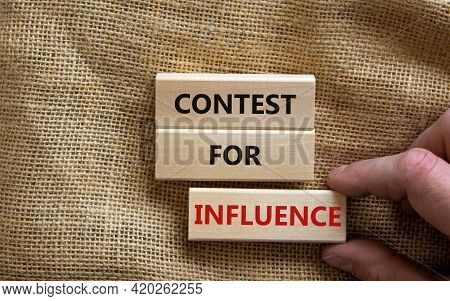 Contest For Influence Symbol. Wooden Blocks With Words 'contest For Influence'. Beautiful Canvas Bac
