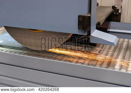 Automatic Cnc Surface Grinding Wheel Machine Working With Sheet Metal With Sparks At Factory, Plant.