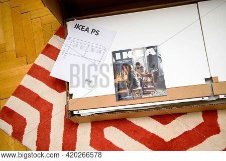 Paris, France - April 17, 2017: Ikea Catalogue Above The Cardboard Box With New Disassembled Furnitu