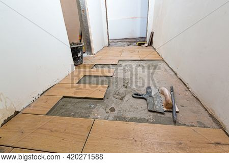 Process Of Installation Of Parquet Tiles Or Laminate In Apartment Is Under Construction, Remodeling,