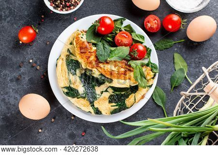 Omelet With Spinach Leaves, Diet Food, Omelette On White Plate, Morning Breakfast. Top View.