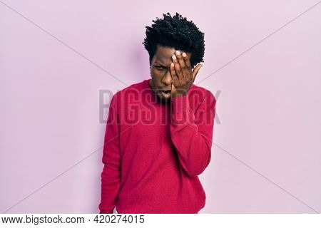Young african american man wearing casual clothes yawning tired covering half face, eye and mouth with hand. face hurts in pain.