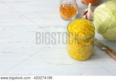 Homemade Sauerkraut With Garlic, Onion And Turmeric On A Light Blue Background. Healthy Fermented Fo