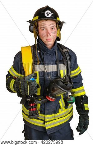 Young Brave Man With Sweaty And Dirty Face In Uniform, Hardhat Of Firefighter And With Fire Hose Loo