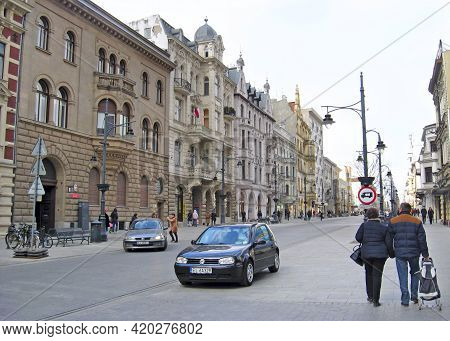 Lodz - Poland. 18 April 2019: City Life In Lodz. Busy Traffic On Streets Of Polish City Of Lodz. Tra