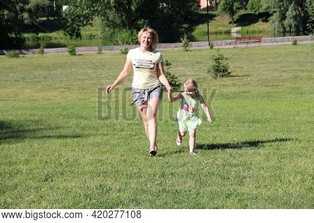 Happy Mother With Child Enjoy Good Weather. Family Holidays. Happy Mother Running Together With Daug