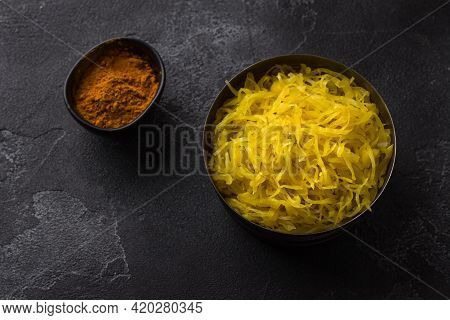 Homemade Sauerkraut With Garlic, Onion And Turmeric On A Dark Textured Background. Healthy Fermented