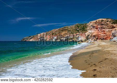 Greek beach in Greece view - Paleochori beach and waves of Aegean sea, Milos island, Cyclades, Greece. Slow motion