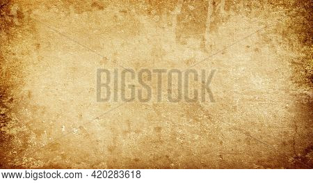 Grunge Background Made Of Old Faded Brown Paper With Space For Text