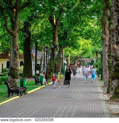 Sochi, Russia - June 13, 2020: Green Alley In The Riviera Park. Footpath. People On A Walk