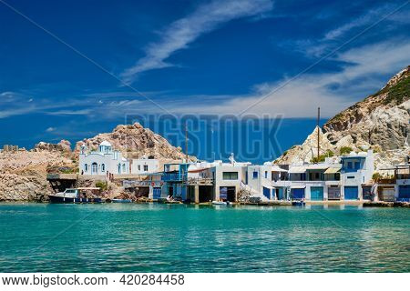Greek village scenic picturesque view in Greece - the beach and fishing village of Firapotamos in Milos island, Greece