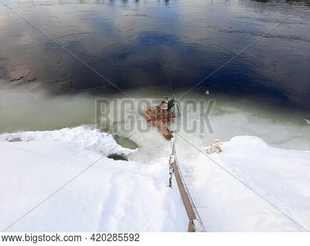 Ice Fishing. Winter Fishing, Catching A Fish