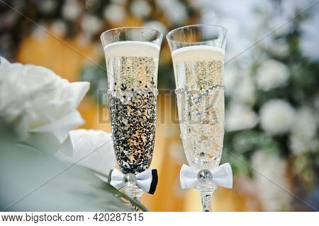 Bride And Groom Champagne Glasses. Wedding Glasses Of The Bride And Groom. Glass Decor