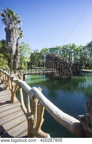 Cambrils, Spain, May 1, 2020 - Picturesque Emerald Green Water Pond In Botanical Garden Park Sama. F