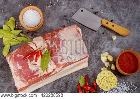 Pork Belly With Spices And Meat Cleaver. Preparation Ukrainian Dish.