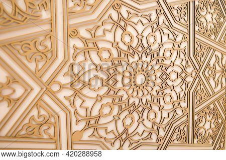 Beautiful Pattern On The Wall Carved From Wood In Oriental Style. Wood Background For Text Or Advert