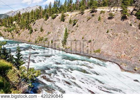 Roaring Rapids Along Bow Falls Trail Flowing Toward Bow Falls, A Major Waterfall On The Bow River In