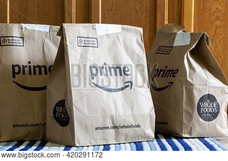 Clarksburg, Md, Usa 05-12-2021: Three Recycled Paper Grocery Bags With Amazon Prime And Whole Foods