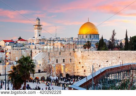 Jerusalem, Israel at the Western Wall and Dome of the Rock at dusk in the old city.