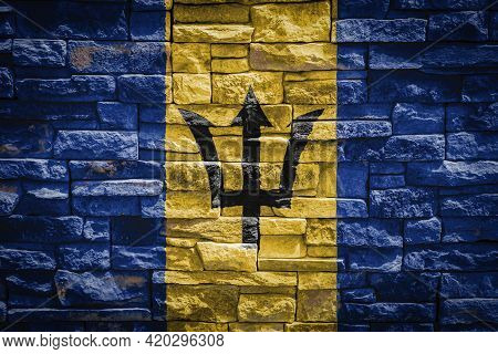 National Flag Of Barbados On Stone  Wall Background.the Concept Of National Pride And Symbol Of The