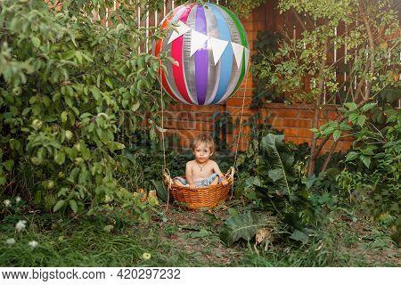 The Toy Air Balloon For Child. Hot Air Balloon. Cute Child On Airship. Kid Riding Hot Air Balloon. H