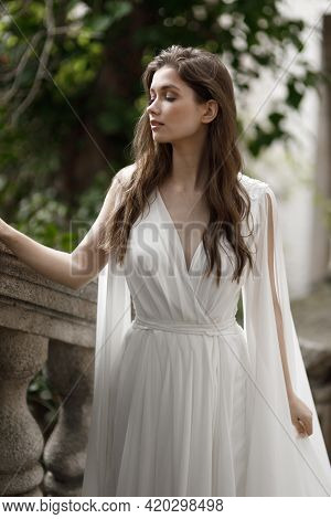 Wedding In An Old Villa In European Style, Trends 2021. The Bride Walks Up The Stairs Of The Villa O
