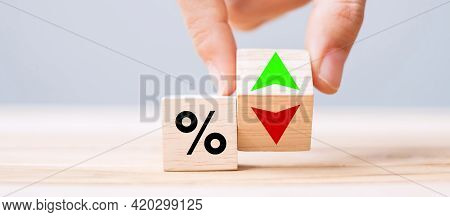Business Man Hand Change Wood Cube Block With Percentage To Up And Down Arrow Symbol Icon. Interest