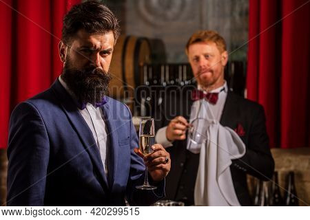 Professional Bartender. Man In Bar. Making Cocktail At Nightclub. Customers Service.