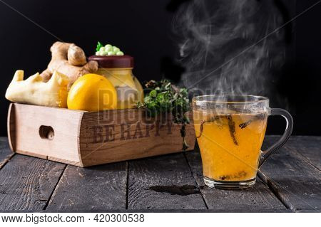 Hot Tea With Ginger Root. Tea With Lemon And Ginger. Healing Tea. Steam Tea On The Table. Front View