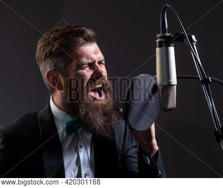 Classical Music. Man Singing Song. Musician In Music Hall. Funny Guy Singing In Karaoke.