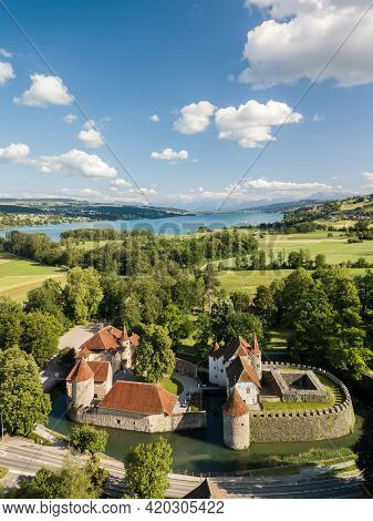 Seengen, Switzerland - May 25.2020: Aerial Image Of Moated Hallwyl Castle In Canton Aargau With Lake