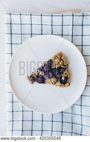Piece Of Freshly Baked Oat Blueberry Scones On White Plate, Close Up. Sweet Food With Natural Ingred