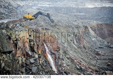 Belarus. November 2014 - The Excavator Works In A Granite Quarry. Production Extraction Of Granite S