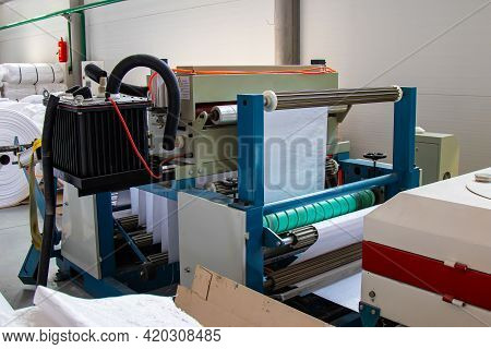 Weaving Plant For The Production Of Plastic Or Polypropylene Bags. Roll Ready-made Plastic Bags On T