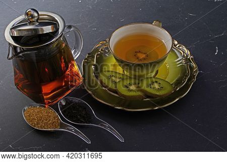 Black Tea With Kiwi In A Cup , Teapot,kiwi In Slices