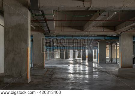 Vacant Parking Lot In Car Park Building At Condominium. Empty Car Parking Garage In The Afternoon. S
