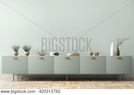 Interior Design Of Living Room With Dresser Over Green Wall.  Home Decor Background With Accessories