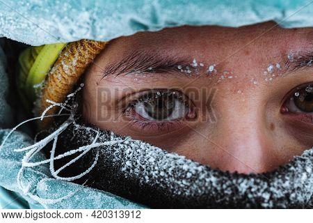 Closeup of a female mountaineer in wintertime at Glen Coe, Scotland