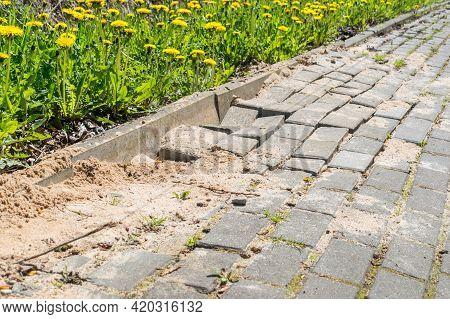 Defective Cobblestone Pavement Due To Incorrectly Prepared Base.