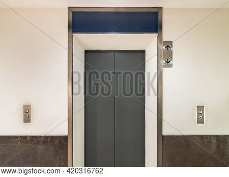 Elevator Chrome Metal With Closed Door In Condominium. Lift Transportation Floor To Floors With Push