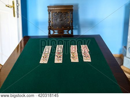 Wygiezlow, Poland - August 14, 2020: Playing Cards Table With Cards Unfolded In The Manor House Of A