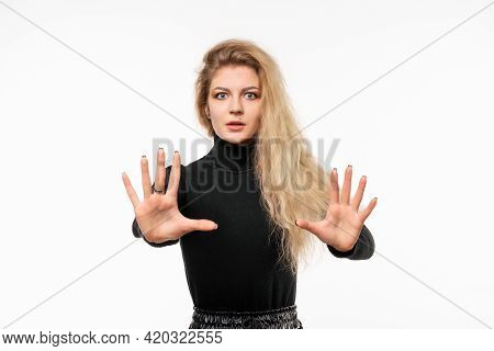 Blonde Girl Feeling Stupefied And Scared, Fearing Something Frightening, With Hands Open Up Front Sa