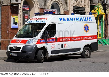 Ambulance Car On The Road. A Resuscitation Medical Ambulance Came To The Patient For The Treatment O