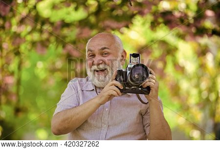 Hobby At Happy Retirement. Tourism And Holiday. Traveler Camera Man Under Sakura Bloom. Travel Conce